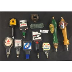 9 Beer Taps Plus a Bear Face Wall Mount Bottle Opener and A BS Corner Sign for the Bar. All Beer Tap