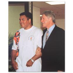 Muhammad Ali with Bill Clinton (walking) by Ali, Muhammad