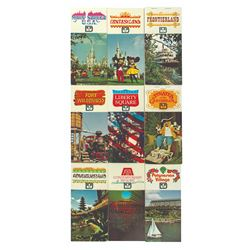 Set of (9) Walt Disney World Postcard Booklets.