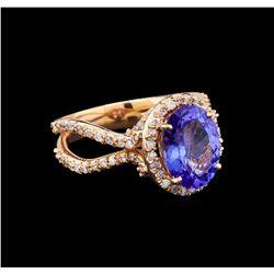 14KT Rose Gold 4.34 ctw Tanzanite and Diamond Ring