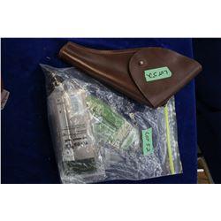 Bag of Scope Ring Mounts, a Choke & a Hand Gun Holster