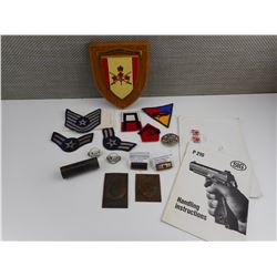 ASSORTED MILITARY BADGES, PATCHES, RIBBONS, A PLAQUE AND LAW ENFORCEMENT SHIELDS