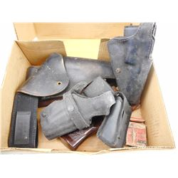 ASSORTED BLACK HOLSTERS AND HAND GUN GRIPS