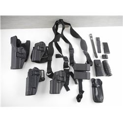 ASSORTED BLACK HOLSTERS AND POUCHES