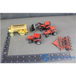 Metal Toy Farm Equipment and Gold Coloured Case Train