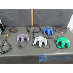 (4) Nintendo 64 Controllers & Assorted Cables