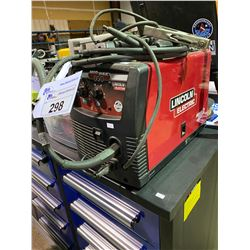 LINCOLN ELECTRIC MIG-PAK 140 PORTABLE WELDING UNIT INCLUDES A BIN OF RODS AND GLOVES