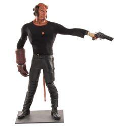 Ron Perlman 'Hellboy' shirt, stunt Samaritan gun & tracer bullet on display figure from Hellboy.
