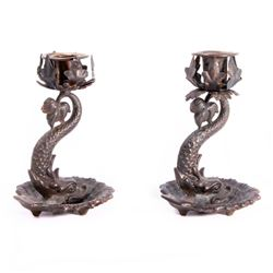 A pair of Dolphin candlesticks.