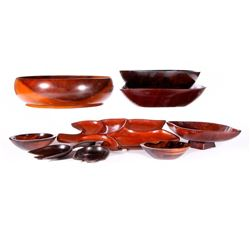 Three groups of carved wooden bowls.