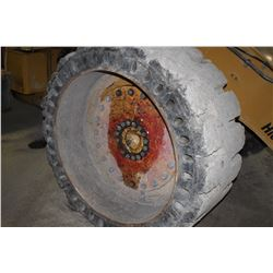 set of 4 solid tires and rims to fit Cat 930 wheel loader