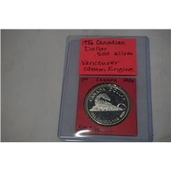 1986 CANADIAN SILVER DOLLAR .500 SILVER, VANCOUVER STEAM ENGINE TRANSCONTINENTAL RAILWAY