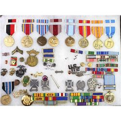 Large collection of US military metals and pins.