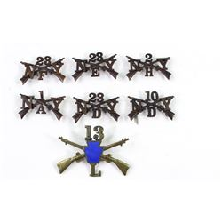 Collection of 7 US Infantry cap insignia includes 6) NY and 1) Pennsylvania National Guard.includes