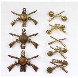 Collection of 8 US Infantry cap insignia includes 3) Indian Wars period.includes 3) Indian Wars peri