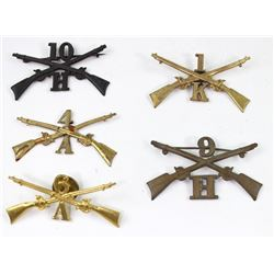 Collection of 5 US Infantry cap insignia.