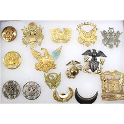 Collection of US military insignia and hat plates.