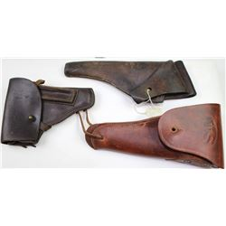 Collection of 3 leather holsters includes German P35 unmarked and 2) US flap holsters.German P35 unm