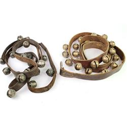 Two strands of leather and brass sleigh bells.