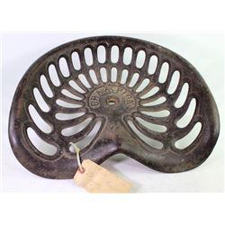 Antique Champion cast iron implement seat NO breaks or repairs.NO breaks or repairs.