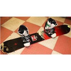 SNOWBOARD WITH BINDINGS WITH SNOWBOARD BOOTS.