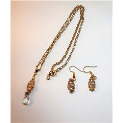 17)  GOLD TONE WITH WHITE CRYSTAL