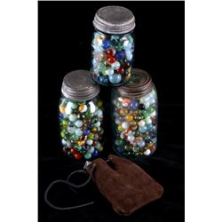 Collection of Marbles in Jars & Marble Pouch