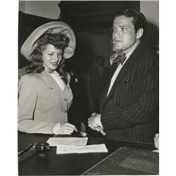 Rita Hayworth (5) photographs from her courthouse marriage to Orson Welles.