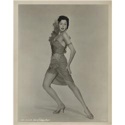 Ann Miller (30+) glamour pose photographs.