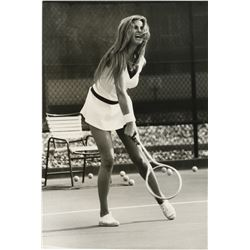 Raquel Welch (6) candid photographs playing tennis.