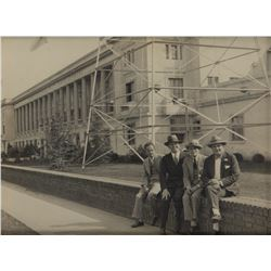 Darryl F. Zanuck with three Warner brothers in front of Warner Brothers West Coast Studios photo.