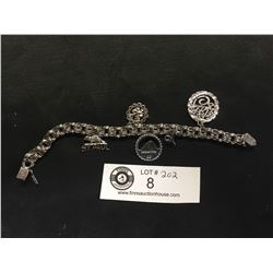 A Good Sterling Silver Charm Bracelet with Charms.