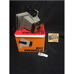Polaroid Big Swinger Model 3000 Camera with a Bell and Howell Camera Flash