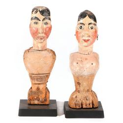 Couple of carved folk art partial figures