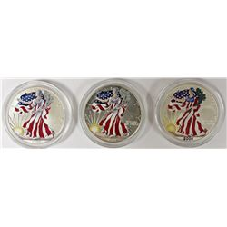 THREE COLORIZED AMERICAN SILVER EAGLES