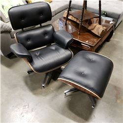 AS NEW EAMES BLACK LEATHER AND TEAK FINISH SWIVEL CHAIR AND OTTOMAN , RETAIL $1399