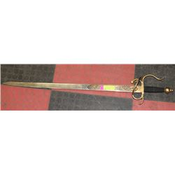 ORNATE GOLD TONE SPANISH SWORD MARKED TOLEDO.