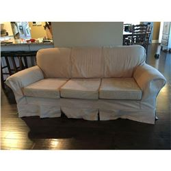 """Covered couch - floral pattern underneath protective cover 6'8""""W x 3'2""""D x 2'7""""H"""