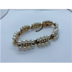 LADIES 14K YELLOW GOLD BRACELET CONTAINING 104 PEARLS RV $1,470.00
