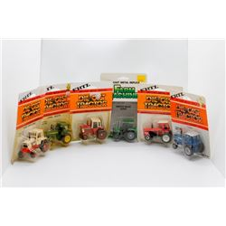 Various 1:64 scale tractors