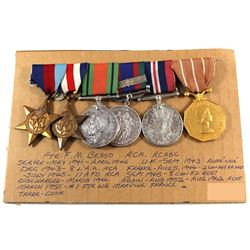 Named EIIR Canadian Forces Decoration Medal, Voluntary WWII Medal, 1939-1945 War Medal, 1939-1945 De