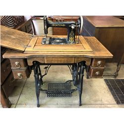 EATON'S ANTIQUE TREADLE SEWING MACHINE IN CABINET