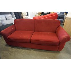 RED ROLLED ARM SOFA