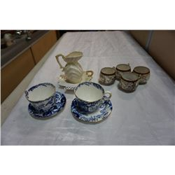 BELLEEK CREAMER, ROYAL CROWN DERBY CUPS AND SAUCERS, AND PORTRAIT CUPS