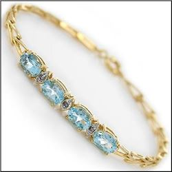 Plated 18KT Yellow Gold 5.29ctw Blue Topaz and Diamond Bracelet
