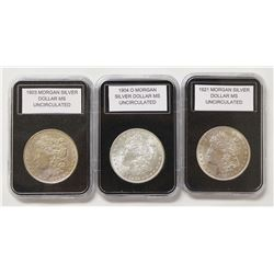 THREE MORGAN SILVER DOLLARS: