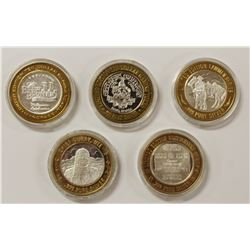FIVE MISCELLANEOUS SILVER CASINO TOKENS