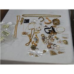 2 BAGS OF GOLD TONE JEWELLERY AND RINGS