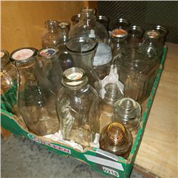 TRAY OF MOSTLY VINTAGE GLASS MILK BOTTLES AND GLASS JARS