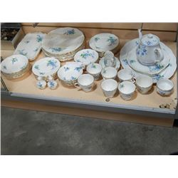 59 PIECES ROYAL ALBERT FORGET ME NOT CHINA, CUPS AND SAUCERS, PLATES, BOWLS AND PLATTERS. TEAPOT IS